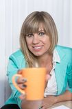 Woman is holding a cup of coffee Royalty Free Stock Photo