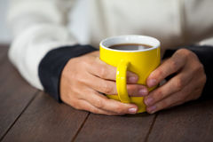 Woman holding a cup of coffee Stock Images
