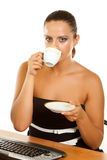 Woman holding a cup of coffee Royalty Free Stock Photography