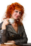 Woman holding a cup of coffee Royalty Free Stock Images