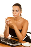 Woman holding a cup of coffee Royalty Free Stock Image