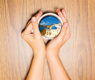 Woman holding cup with dream about vacation. Against wooden table. Top view. Conceptual photo Stock Photography