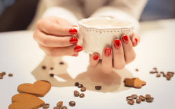 Woman holding a cup of hot drink Royalty Free Stock Photography