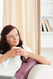 Woman holding a cup looking out of the window Royalty Free Stock Photos