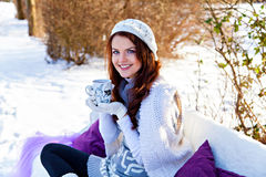 Woman holding a cup of tea in hand outdoors Stock Photos