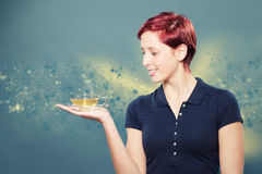 Woman holding a cup of tea Stock Image