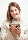 Woman holding cup of tea. Vapor forming heart Royalty Free Stock Photos