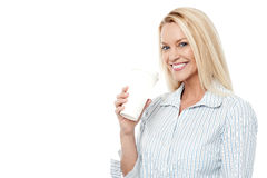 Woman holding cup on white background Stock Photo