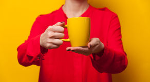 Woman holding cup Royalty Free Stock Images