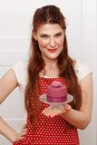 Woman holding cupcake Royalty Free Stock Photo
