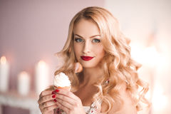 Woman holding cupcake Royalty Free Stock Photography
