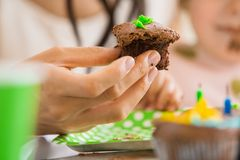 Woman Holding Cupcake At Birthday Party Stock Photography