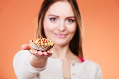 Woman holding cupcake decorated chocolate Stock Images