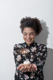 Woman holding a cupcake with a sparkler Stock Photo
