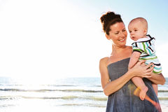 Woman holding cute child. Royalty Free Stock Photography