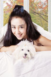 Woman holding cute dog under blanket Royalty Free Stock Photo