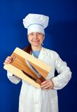 Woman holding cutting board and knives Stock Image