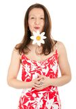 Woman holding daisy Stock Image
