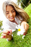 Woman holding a daisy Stock Photo