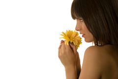 Woman holding a daisy Stock Images