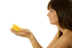 Woman holding a daisy Stock Photography