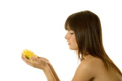 Woman holding a daisy Royalty Free Stock Photos