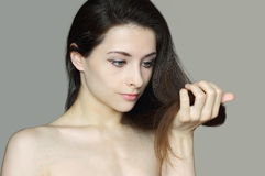 Woman holding damaged hair Royalty Free Stock Images