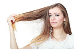 Woman holding damaged hair Stock Photo