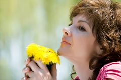 Woman holding dandelions stock photography