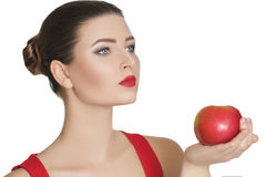 Woman holding a dark red Apple. healthy eating. Beautiful brunette woman with red lipstick holding a dark red Apple. healthy eating Stock Images