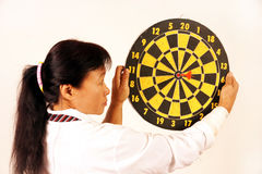 Woman holding dart target. Arrow royalty free stock photos