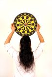 Woman holding dart target. Arrow royalty free stock image