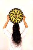 Woman holding dart target Royalty Free Stock Image