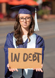Woman Holding In Debt Sign Royalty Free Stock Photo