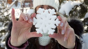 Woman holding a decorative snowflake stock footage