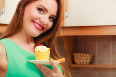 Woman holding delicious sweet cake. Gluttony. Royalty Free Stock Photos