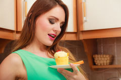 Woman holding delicious sweet cake. Gluttony. Stock Images