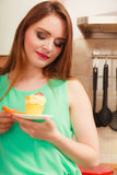 Woman holding delicious sweet cake. Gluttony. Royalty Free Stock Photo