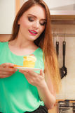 Woman holding delicious sweet cake. Gluttony. Stock Photos