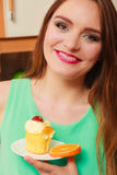Woman holding delicious sweet cake. Gluttony. Stock Photo