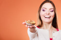 Woman holding delicious sweet cupcake. Gluttony. Royalty Free Stock Image
