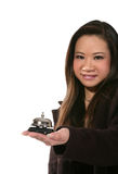 Woman holding desk bell royalty free stock photo