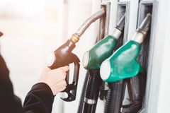 Woman holding diesel fuel nozzle Royalty Free Stock Images