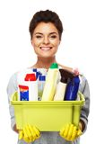 Woman  holding different cleaning stuff Royalty Free Stock Images