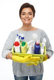 Woman holding different cleaning stuff Royalty Free Stock Photo