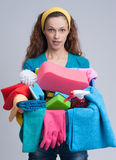 Woman holding different cleaning stuff Stock Images
