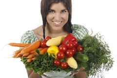 Woman holding different fresh vegetables. Isolated on white Stock Image