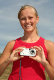 Woman holding digital camera royalty free stock images