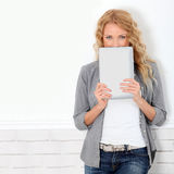 Woman holding digital tablet Stock Image