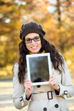 Woman holding digital tablet in autumn Royalty Free Stock Photography